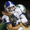 Antlers quarterback Joel Blumenthal is dragged down by McGuinness\' Danny Krenger in the second quarter. Deer Creek Antlers vs. Bishop McGuinness Fighting Irish at Pribil Stadium Friday night, Nov. 2, 2012. Photo by Jim Beckel, The Oklahoman