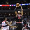 Chicago Bulls forward Taj Gibson (22) takes a shot against Washington Wizards forward Kevin Seraphin (13) during the first half of an NBA basketball game, Saturday, Jan. 26, 2013, in Washington. (AP Photo/Nick Wass)