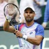 Photo - Colombia's Alejandro Falla celebrates after beating Germany's Philipp Kohlschreiber during the semifinal match of the the Gerry Weber Open tennis tournament in Halle, Germany, Saturday, June 14, 2014. Falla won the match with 5-7, 7-6, 6-4. (AP Photo/Michael Probst)
