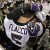 Photo - Baltimore Ravens quarterback Joe Flacco (5) embraces linebacker Ray Lewis after defeating the San Francisco 49ers 34-31 in the NFL Super Bowl XLVII football game, Sunday, Feb. 3, 2013, in New Orleans. (AP Photo/Matt Slocum)