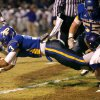 Piedmont\'s Darrius Burris leaps for extra yards against Anadarko during their high school football game in Piedmont, Okla., Friday, October 25, 2013. Photo by Bryan Terry, The Oklahoman