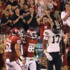 Missouri\'s Matt White (17) walks away as Oklahoma\'s Ryan Broyles (85) and Ben Habern (61) celebrate Broyles touchdown during their game on Saturday in Norman. Photo by Chris Landsberger, The Oklahoman
