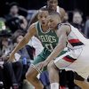 Portland Trail Blazers guard Damian Lillard, right, loses control of the ball as Boston Celtics guard Avery Bradley defends during the first quarter of an NBA basketball game in Portland, Ore., Sunday, Feb. 24, 2013. (AP Photo/Don Ryan)