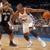 Oklahoma City Thunder\'s Kevin Durant (35) tries to get past San Antonio Spurs\' Kawhi Leonard (2) during the the NBA basketball game between the Oklahoma City Thunder and the San Antonio Spurs at the Chesapeake Energy Arena in Oklahoma City, Sunday, Jan. 8, 2012. Photo by Sarah Phipps, The Oklahoman