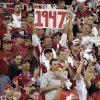 A fan holds a sign indicating the year, 1947, that the arizona Cardinals\' last hosted a home playoff game, during the first quarter of an NFL wild-card playoff football game against the Atlanta Falcons Saturday, Jan. 3, 2009 in Glendale, Ariz. (AP Photo/Matt York) ORG XMIT: PNP110