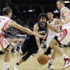 Minnesota Timberwolves\' Ricky Rubio, center, drives the ball between Houston Rockets Chandler Parsons (25), Jeremy Lin (7) and Donatas Motiejunas, right, in the first half of an NBA basketball game Friday, March 15, 2013, in Houston. (AP Photo/Pat Sullivan)