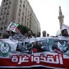 Egyptian protesters hold a banner with Arabic that reads,