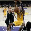 Los Angeles Lakers\' Dwight Howard, right, dunks against Brooklyn Nets\' Brook Lopez, left, in the first half of an NBA basketball game in Los Angeles, Tuesday, Nov. 20, 2012. (AP Photo/Jae C. Hong)
