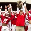 Photo - Nebraska head coach Bo Pelini holds a cat as the team emerge from the tunnel prior to Nebraska's Red-White spring NCAA college football game on Saturday, April 12, 2014, in Lincoln, Neb. (AP Photo/The Journal-Star, Francis Gardler)