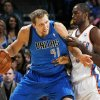 Dirk Nowitzki (41) of Dallas tries to get the ball past the defense of Oklahoma City\'s Serge Ibaka (9) during the NBA basketball game between the Dallas Mavericks and the Oklahoma City Thunder at the Oklahoma City Arena in Oklahoma City, Monday, Dec. 27, 2010. Photo by Nate Billings, The Oklahoman