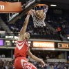 Photo - Houston Rockets guard Jeremy Lin dunks against the Sacramento Kings during the first quarter of an NBA basketball game in Sacramento, Calif., Wednesday, April 3, 2013. (AP Photo/Rich Pedroncelli)