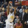West Virginia\'s Terry Henderson (15) dunks during the first half of an NCAA college basketball game against Iowa State, Monday, Feb. 10, 2014, in Morgantown, W.Va. (AP Photo/Andrew Ferguson)