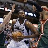 Dallas Mavericks\' Elton Brand, center, fights for a shot opportunity against Milwaukee Bucks\' Mike Dunleavy (17) and Drew Gooden, right, during the second half of an NBA basketball game Tuesday, Feb. 26, 2013, in Dallas. The Bucks won 95-90. (AP Photo/Tony Gutierrez)