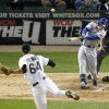 Photo - Kansas City Royals' David Lough, right, hits a two-run home run off Chicago White Sox starting pitcher Andre Rienzo during the fourth inning of a baseball game Thursday, Sept. 26, 2013, in Chicago. (AP Photo/Charles Rex Arbogast)