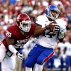 Oklahoma Sooners\'s Chuka Ndulue (98) sacks Michael Cummings during the college football game between the University of Oklahoma Sooners (OU) and the University of Kansas Jayhawks (KU) at Gaylord Family-Oklahoma Memorial Stadium in Norman, Okla., on Saturday, Oct. 20, 2012. Photo by Steve Sisney, The Oklahoman