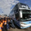 Argentina\'s soccer team arrives in a bus as fans gather to welcome them home in Buenos Aires, Argentina, Monday, July 14, 2014. Argentina was defeated 1-0 by Germany at the the Brazil World Cup final match on Sunday. (AP Photo/Daniel Jayo)