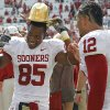 Oklahoma\'s Ryan Broyles (85) and Travis Lewis (12) celebrate with the Golden Hat trophy after the Sooners 55-17 win over Texas during the Red River Rivalry college football game between the University of Oklahoma Sooners (OU) and the University of Texas Longhorns (UT) at the Cotton Bowl in Dallas, Saturday, Oct. 8, 2011. Photo by Chris Landsberger, The Oklahoman
