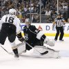 Photo - Anaheim Ducks right wing Tim Jackman, left, scores a goal past Los Angeles Kings goalie Martin Jones, right, during the first period of an NHL hockey game in Los Angeles, Saturday, March 15, 2014. (AP Photo/Danny Moloshok)