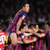 Photo - FC Barcelona players celebrate Lionel Messi's goal during a Spanish La Liga soccer match against Athletic Bilbao at the Camp Nou stadium in Barcelona, Spain, Sunday April 20, 2014. (AP Photo/Manu Fernandez)