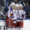 New York Rangers center Derek Stepan, center, celebrates with teammates Anton Stralman, left, and Carl Hagelin, right, after scoring against the Tampa Bay Lightning during the second period of an NHL hockey game on Saturday, Feb. 2, 2013, in Tampa, Fla. (AP Photo/Chris O\'Meara)