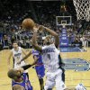 Orlando Magic\'s Arron Afflalo (4) loses control of the ball as he collides with New York Knicks\' Tyson Chandler, lower left, during the first half of an NBA basketball game, Tuesday, Nov. 13, 2012, in Orlando, Fla. (AP Photo/John Raoux)
