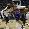 Photo - Detroit Pistons forward Tayshaun Prince (22) attempts to get around Milwaukee Bucks forward Luc Richard Mbah a Moute during the first half of an NBA basketball game Friday, Jan. 11, 2013, in Milwaukee. (AP Photo/Morry Gash)