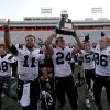 CLASS A HIGH SCHOOL FOOTBALL STATE CHAMPIONSHIP / CELEBRATION: Wayne\'s Josh Way holds up the championship trophy as Sam Martin (11) and Justin Rafferty (86) celebrate after defeating Woodland in the Class A state championship high school football game at Boone Pickens Stadium in Stillwater, Okla., Saturday, Dec. 10, 2011. Photo by Sarah Phipps, The Oklahoman