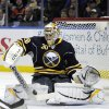 Photo - Buffalo Sabres' Ryan Miller makes a save against the Boston Bruins during the second period of an NHL hockey game in Buffalo, N.Y., Thursday, Dec. 19, 2013. (AP Photo/Gary Wiepert)