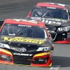 Clint Bowyer leads Kasey Kahne during practice for Sunday\'s NASCAR Sprint Cup series auto race at New Hampshire Motor Speedway, Saturday, Sept. 21, 2013, in Loudon, N.H. (AP Photo/Jim Cole)