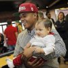 Heritage Hall\'s Sterling Shepard holds his 9-month-old cousin Drake Shepard after the National Signing Day ceremony at Heritage Hall in Oklahoma City, Wednesday, Feb. 1, 2012. Sterling Shepard signed to play football at the University of Oklahoma. Photo by Nate Billings, The Oklahoman