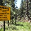 Photo -   FILE - In this July 6, 2010, file photo, a warning sign is seen for hikers entering the area burned in the 2007 Angora Fire, the habitat of the rare black-backed woodpecker, near South Lake Tahoe, Calif. Conservationists are seeking Endangered Species Act protection for the rare woodpecker that feeds on beetles in burned forests. Four groups filed the listing petition Wednesday, May 2, 2012, for the black-backed woodpecker in the Black Hills, the Sierra Nevada and Eastern Cascades of Oregon. (AP Photo/Rich Pedroncelli, File)