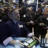 Photo - Specialist Michael Shearin, foreground center, works at his post on the floor of the New York Stock Exchange Wednesday, Jan. 8, 2014.Stocks are mostly lower in early trading as investors hold back ahead of the release of the latest news from the Federal Reserve. (AP Photo/Richard Drew)