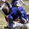 Millwood\'s Cameron Batson is brought down by Lincoln Christian\'s Zack Simmons during a Class 2A high school football playoff game between Millwood and Lincoln Christian in Oklahoma City, Friday, Nov. 25, 2011. Photo by Bryan Terry, The Oklahoman