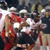 Photo - Arkansas State wide receiver J.D. McKissic (23) is tackled by Ball State linebacker Kenneth Lee (17) in the first quarter of the GoDaddy Bowl NCAA college football game in Mobile, Ala., Sunday, Jan. 5, 2014. (AP Photo/G.M. Andrews)