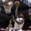Photo - Toronto Raptors Pops Mensah-Bonsu, right, scores as teammate Shawn Marion look on  during the second half of an NBA basketball game, Sunday, March 22, 2009 in Toronto. (AP Photo/The Canadian Press, Chris Young) ORG XMIT: CFWY108