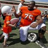 Keeton Metcalf, 3, of Stillwater, slaps hands with Oklahoma State\'s Chris Grisbhy after OSU\'s spring football game at Boone Pickens Stadium in Stillwater, Okla., Sat., April 20, 2013. Photo by Bryan Terry, The Oklahoman