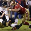 Photo -   Chicago Bears quarterback Jason Campbell (2) is sacked by San Francisco 49ers linebacker Aldon Smith, left, as defensive tackle Justin Smith (94) converges during the first quarter of an NFL football game in San Francisco, Monday, Nov. 19, 2012. (AP Photo/Marcio Jose Sanchez)