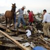 Rescuers recover a horse from the remains of a day care center after a tornado destroyed barns and corals at a ranch behind the strip mall where the day care center was located near SW 149th and Western on Monday, May 20, 2013 in Moore, Okla. Photo by Steve Sisney, The Oklahoman