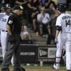 Photo - Chicago White Sox's Paul Konerko (14) looks at home plate umpire Larry Vanover after striking out during the eighth inning of a baseball game against the Detroit Tigers in Chicago, Wednesday, Sept. 11, 2013. Detroit won 1-0. (AP Photo/Paul Beaty)