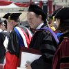 Irish Prime Minister Enda Kenny walks in the procession at Boston College after he received an honorary Doctor of Laws degree during commencement ceremonies at Alumni Stadium in Boston, Monday, May 20, 2013. (AP Photo/Elise Amendola)