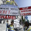 FILE - This Sept. 6, 2011 file photo shows opponents of gay marriage outside a courthouse in San Francisco where the California Supreme Court was hearing arguments on California\'s ban on same-sex marriage. The Supreme Court will take up California\'s ban on same-sex marriage, a case that could give the justices the chance to rule on whether gay Americans have the same constitutional right to marry as heterosexuals. (AP Photo/Eric Risberg, File)