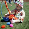 Makalyn Hamilton, 1, plays with eggs during the 100,000 Easter Egg Hunt sponsored by the Cathedral of the Hills Church at Wantland Stadium, Saturday, April 11, 2009, in Edmond, Okla. Photo by Sarah Phipps. The Oklahoman