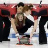 Photo - Canada's skip Jennifer Jones, center, delivers the rock for sweepers Jill Officer, left, and Dawn McEwen, right, during the women's curling competition against Britain at the 2014 Winter Olympics, Wednesday, Feb. 12, 2014, in Sochi, Russia. (AP Photo/Wong Maye-E)