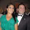 Photo -   In this May 16, 2011 photo Dr. Scott Kelley, right, and his wife Jill Kelley pose for a photo in Tampa, Fla. Jill Kelley's attempt to climb the Tampa social ladder _ the rungs of which included some high-ranking military officials _ has come to an ignominious halt. Accounts of lavish parties at her bayfront mansion have been replaced by reports of her family's financial woes and other dirty laundry, and claims that she traded on her acquaintance with David Petraeus to try to further lucrative business dealings. Now, even her