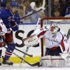 Photo - New York Rangers left wing Chris Kreider (20) reacts as Washington Capitals goalie Braden Holtby (70) makes a save in the first period of Game 6 of their NHL Stanley Cup hockey playoff series in New York, Sunday, May 12, 2013. (AP Photo/Kathy Willens)