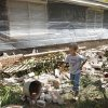 Five-year-old Logan Devereaux walks past some of the bricks that fell from three sides of this home in Sparks, Okla., Sunday, Nov. 6, 2011, following two earthquakes in less than 24 hours. The home owners have placed plastic around the home to try and protect what is left. (AP Photo/Sue Ogrocki) ORG XMIT: OKSO116