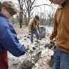 Carrie Wertz and her husband Kenneth try to find a few salvageable remains from their house that was destroyed by wildfires on Friday, April 10, 2009, in Choctaw, Okla. Photo by Chris Landsberger, The Oklahoman