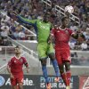 Photo - San Jose Earthquakes midfielderAtiba Harris, right, goes up for a header next to Seattle Sounders' Jalil Anibaba, center, during the first half of an MLS soccer match Saturday, Aug. 2, 2014, in Santa Clara, Calif. (AP Photo/Marcio Jose Sanchez