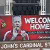 Photo - A sign posted on the scoreboard of Papa John's Cardinal Stadium welcomes the return of Bobby Petrino as the Louisville Cardinals new head football coach Thursday, Jan. 9, 2014, in Louisville, Ky. (AP Photo/Timothy D. Easley)