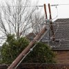 Power pole down on a house near Sorghum Mill and Kelly, Tuesday , February 10, 2009. By David McDaniel, The Oklahoman.